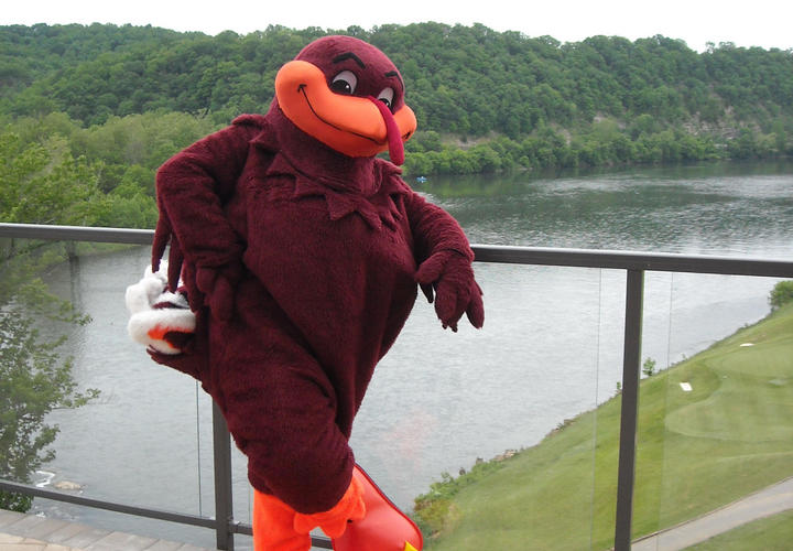 virginia tech hokie mascot on patio of pete dye river course