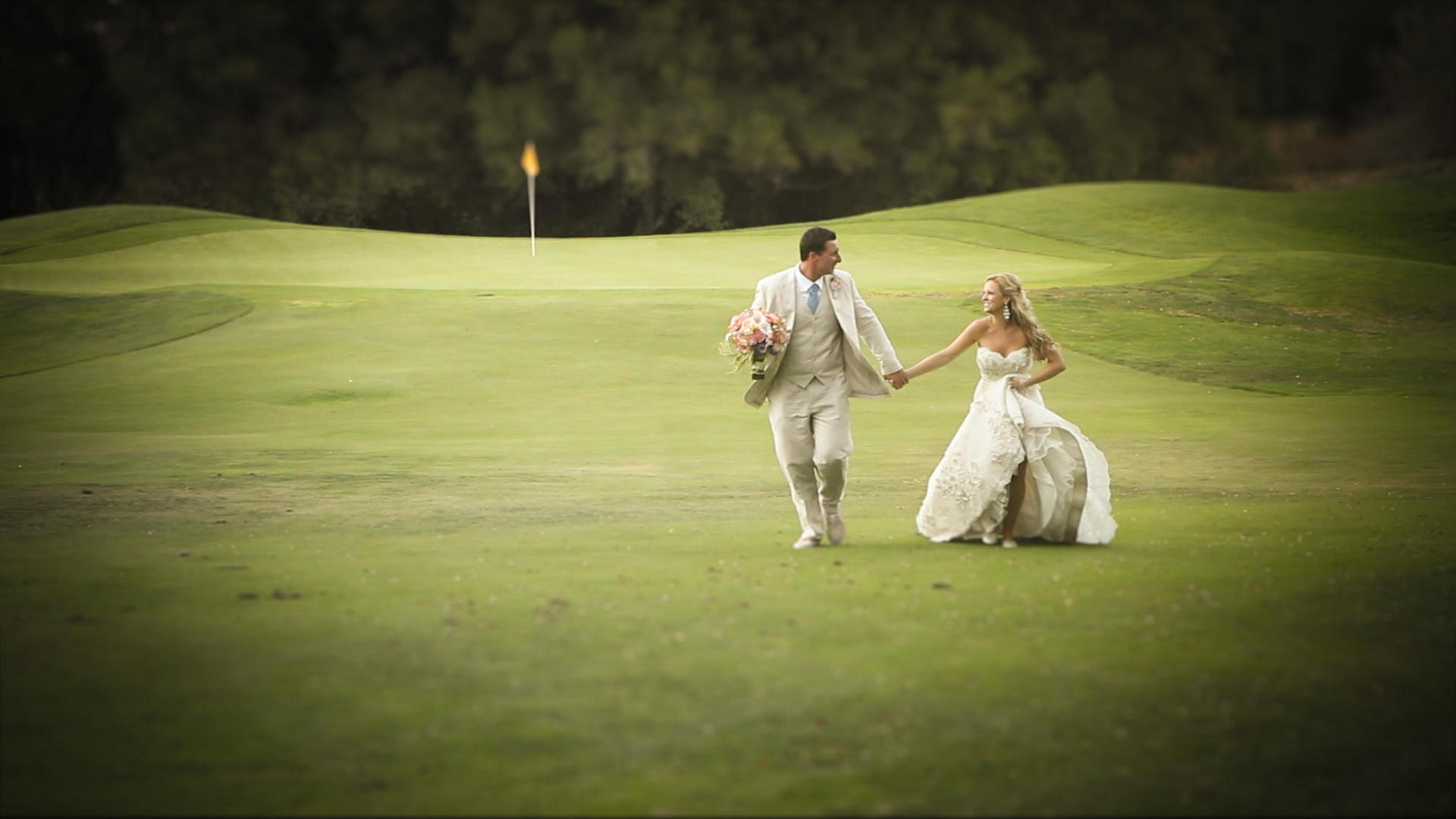 bride and groom kissing on green at pete dye river course